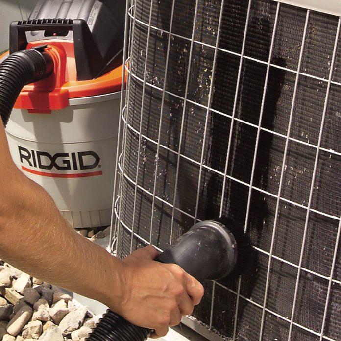 Vacuum away debris on air conditioner