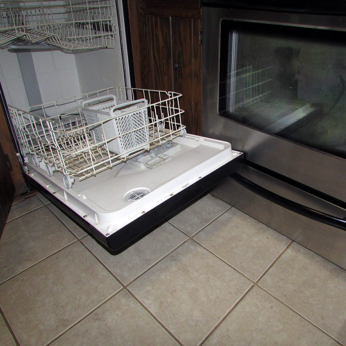 A dishwasher opened and blocking an oven | Construction Pro Tips