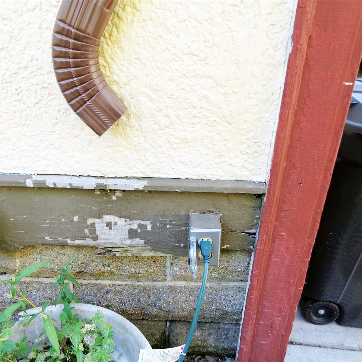 A downspout pointed directly at an outlet | Construction Pro Tips