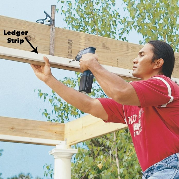 attach ledger strips to beams pergola