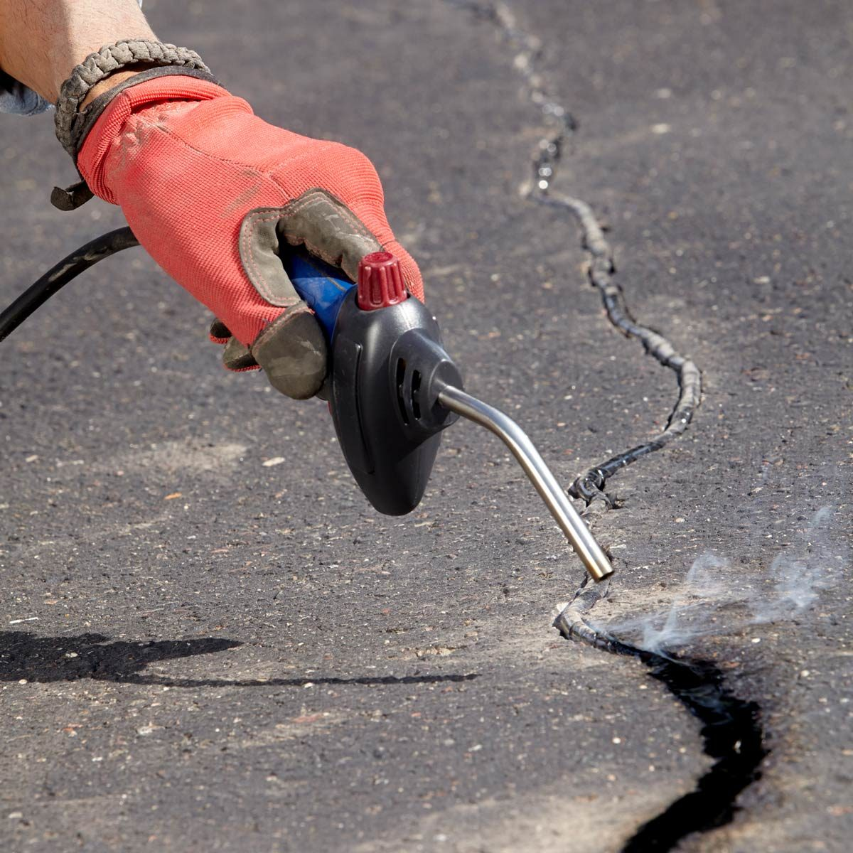 can you patch an asphalt driveway with concrete