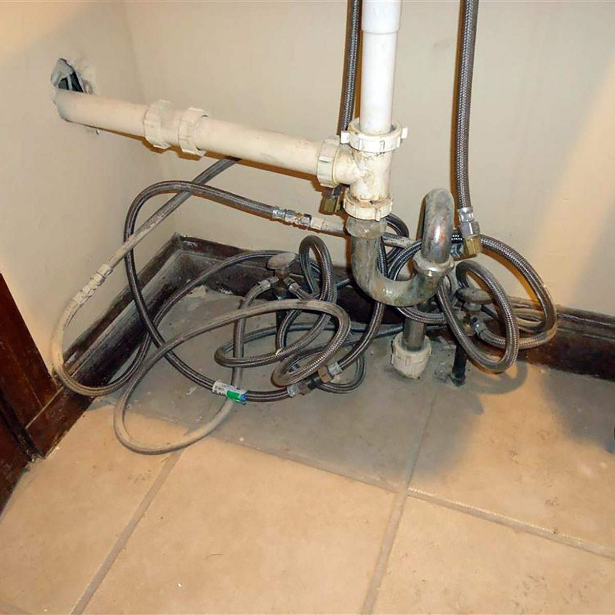 A tangled mess of pipes and plumbing | Construction Pro Tips