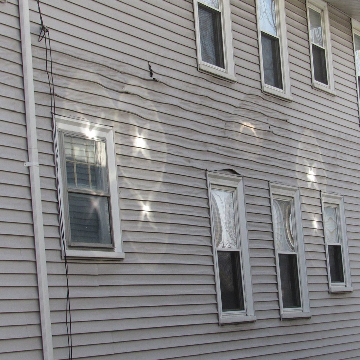 Melted siding on the side of a house | Construction Pro Tips