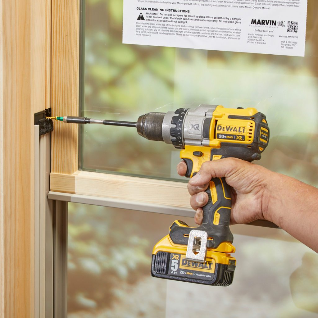 Window being held in place by a screw | Construction Pro Tips