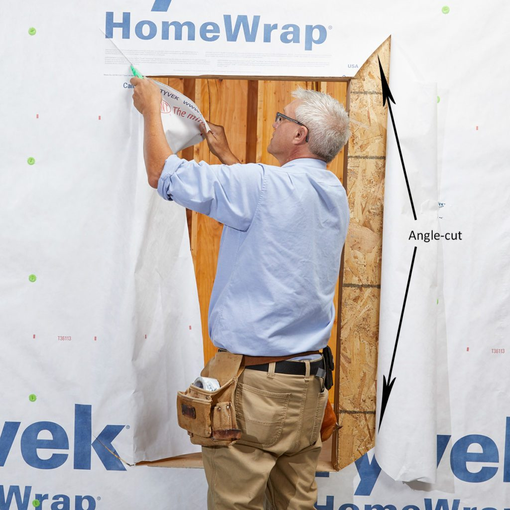 Man cutting angles in the corner of Tyvek | Construction Pro Tips