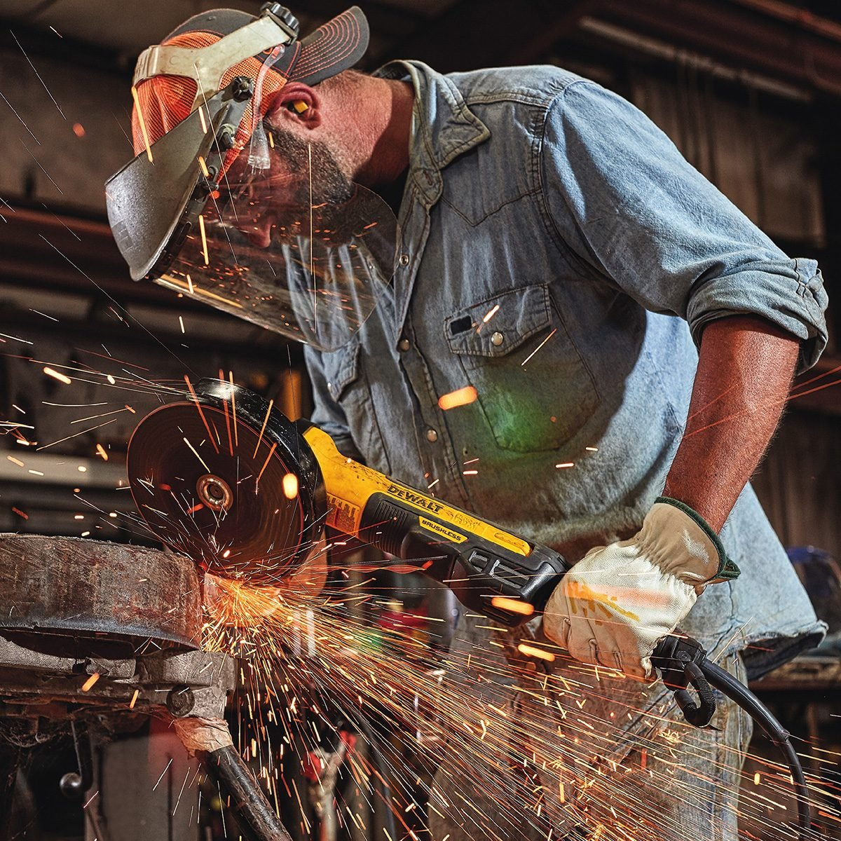 Man using angle grinder while sparks fly everywhere | Construction Pro Tips