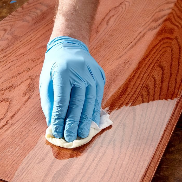 Wiping poly finish on wood with a rag   Construction Pro Tips