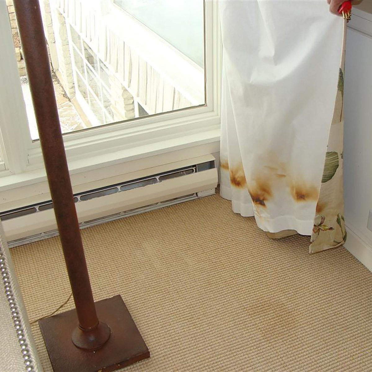 Singed curtains sitting too close to heater | Construction Pro Tips