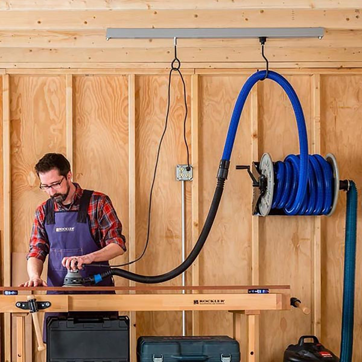 Man using the Rockler Cord Track System | Construction Pro Tips