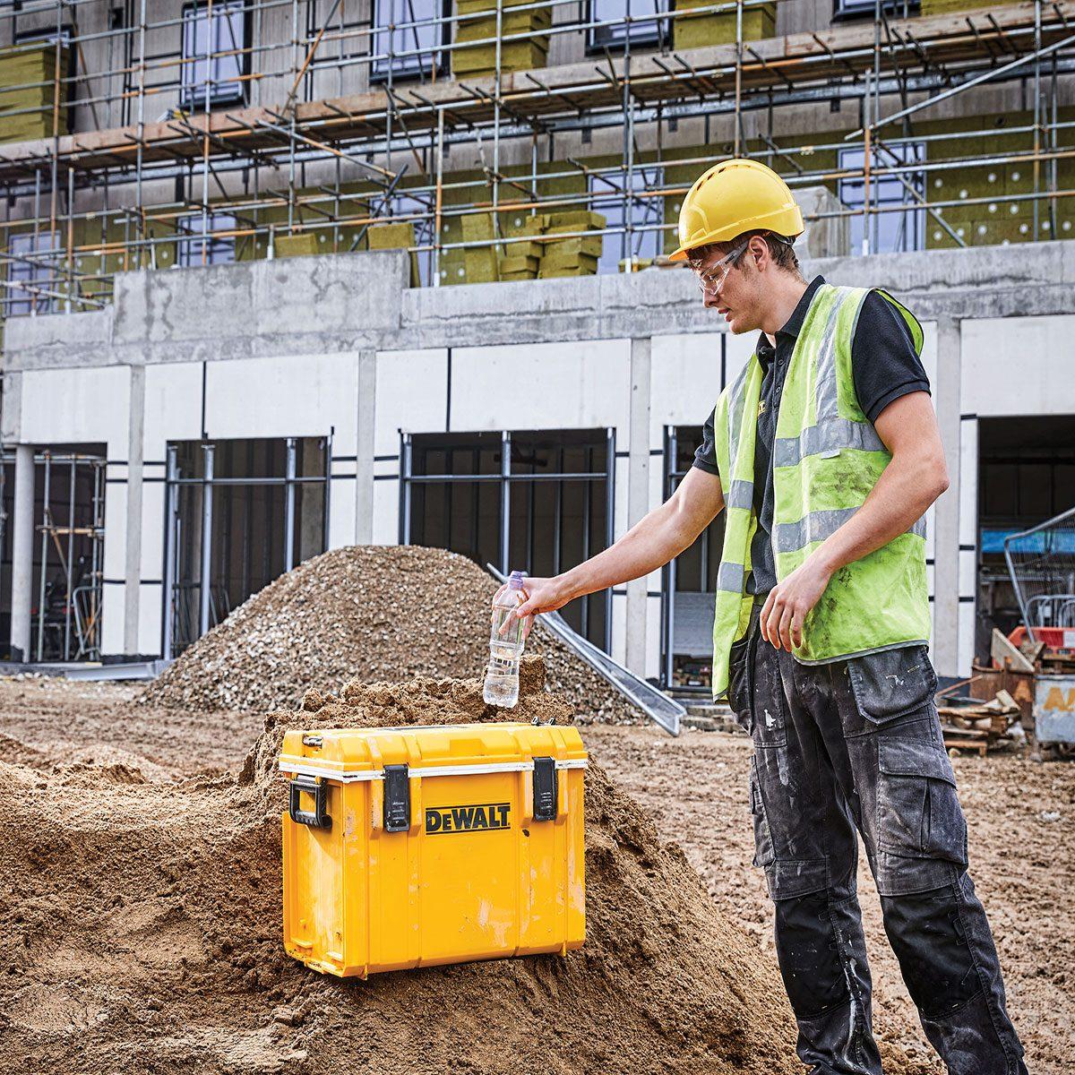 Man using the Jobsite Cooler from DEWALT | Construction Pro Tips
