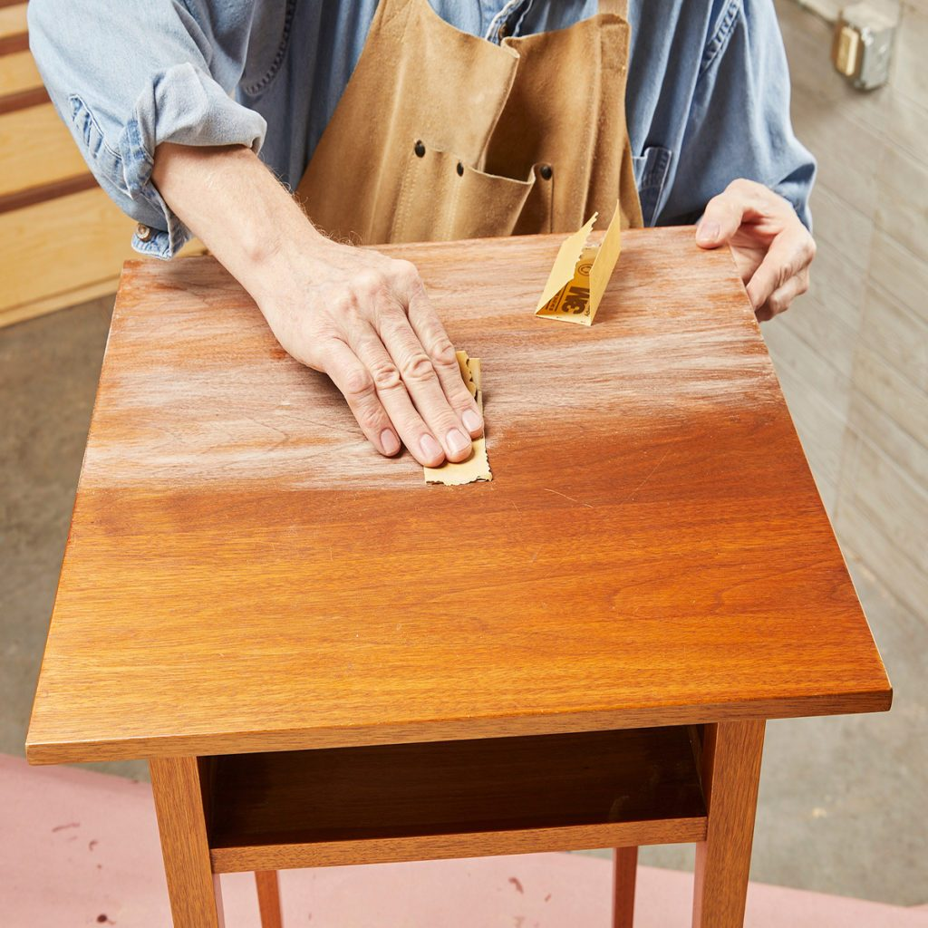 Hand sanding end table top   Construction Pro Tips