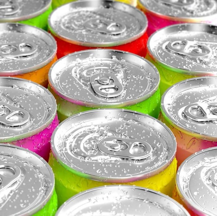 Colorful aluminum cans with water drops.