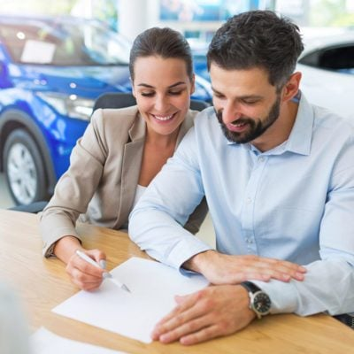 signing car lease papers new car
