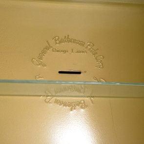 razor disposal slot in medicine cabinet