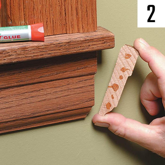 Gluing the cap piece onto the end of a trim joint | Construction Pro Tips