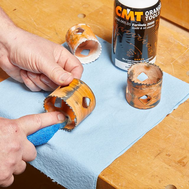 Cleaning hole saws with a cloth and cleaning formula | Construction Pro Tips