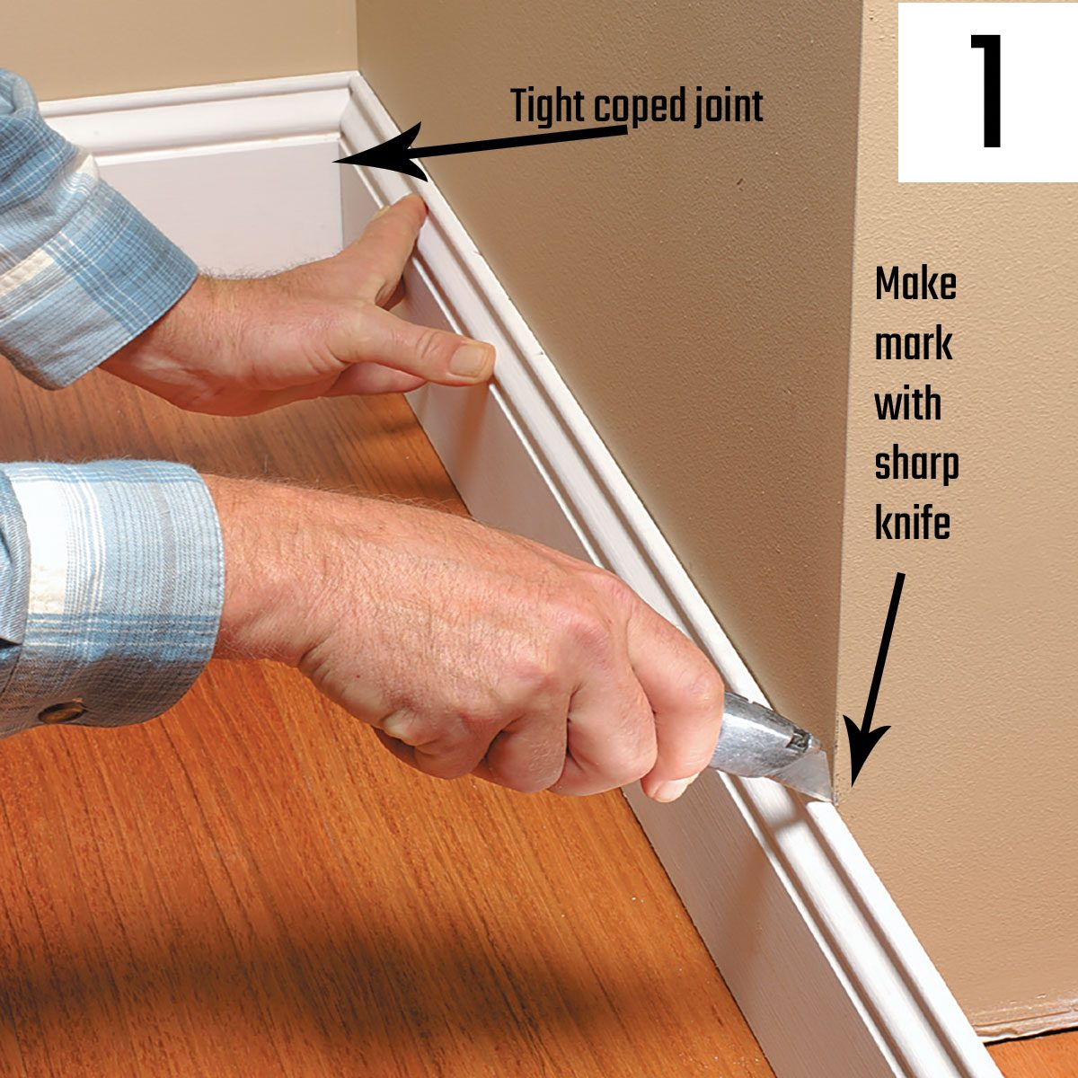 Marking a piece of trim with a utility knife   Construction Pro Tips