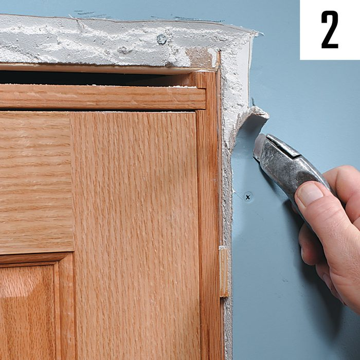 Cutting back drywall around door casing | Construction Pro Tips