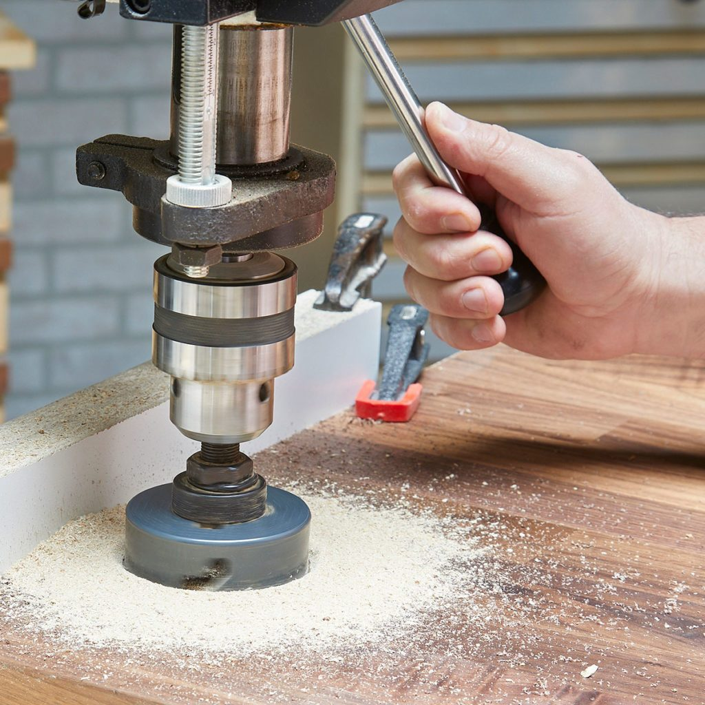 Drill press cutting into wood | Construction Pro Tips