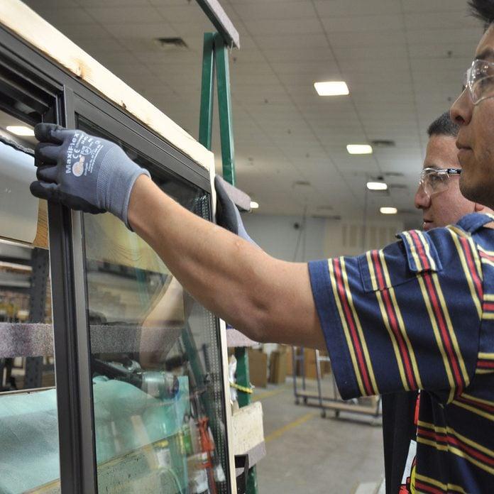 Two men inspecting an Alpen window   Construction Pro Tips