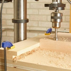 This DIY Drill Press Guide Keeps Sawdust at Bay