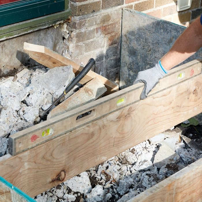 Checking to make sure the step forms are level | Construction Pro Tips