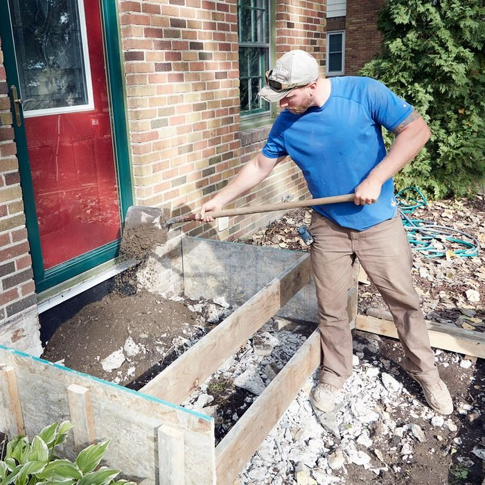 Man adding fill inside the forms for concrete steps | Construction Pro Tips