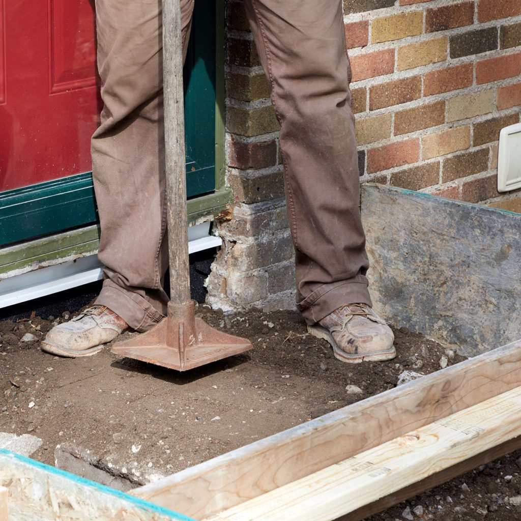 Tamping down the loose fill | Construction Pro Tips