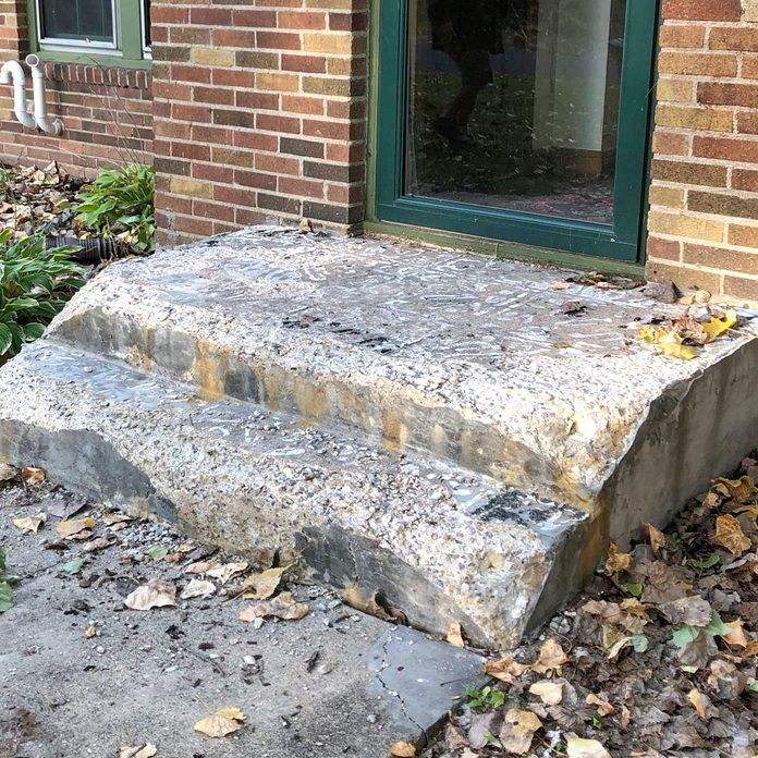 A worn-down old concrete step | Construction Pro Tips