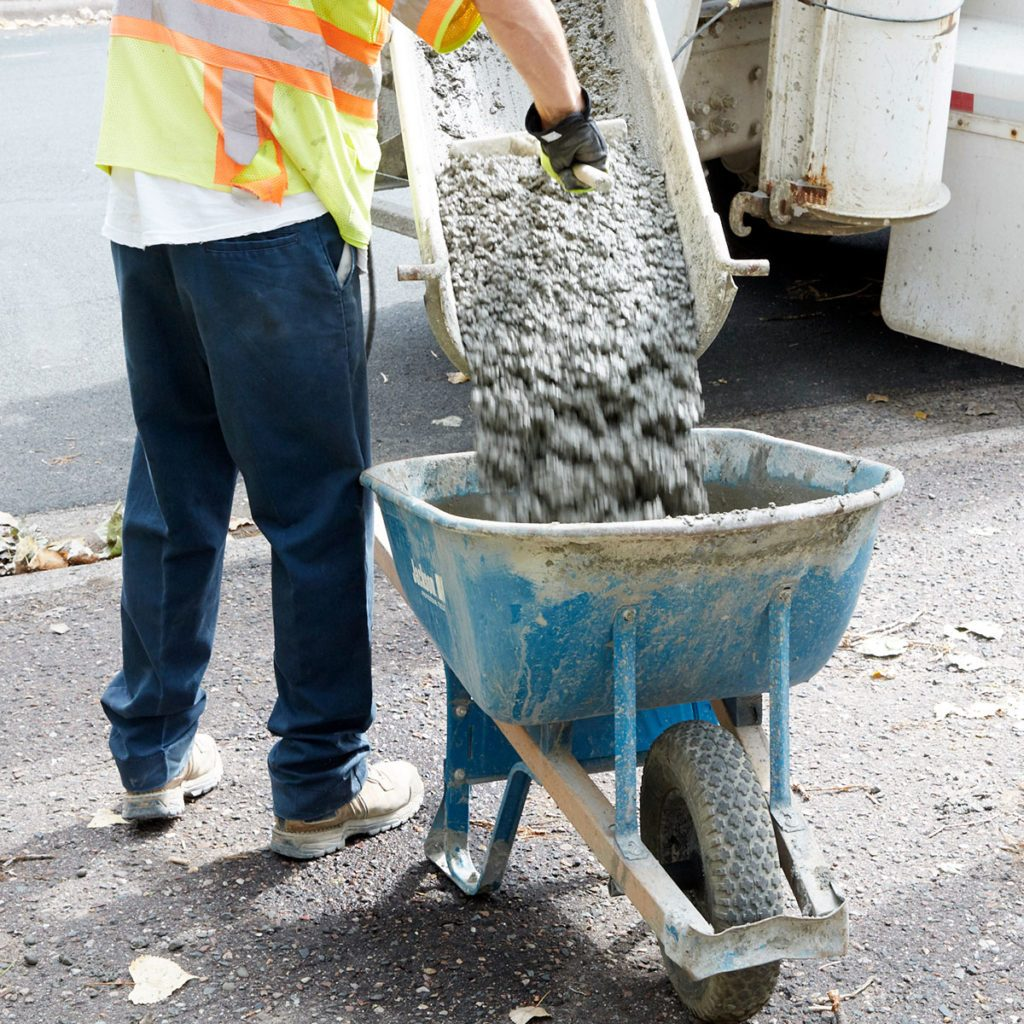 Concrete being poured out at a thick consistency | Construction Pro Tips