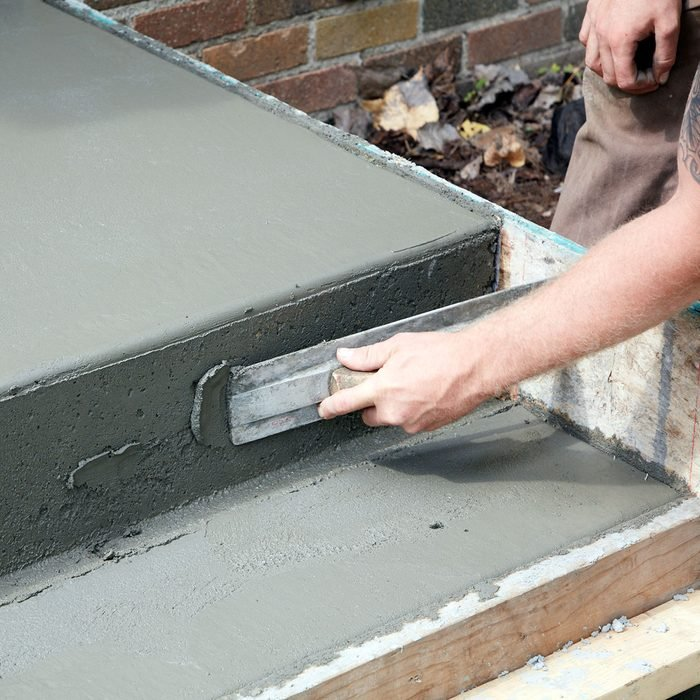 Fill any voids with leftover concrete | Construction Pro Tips