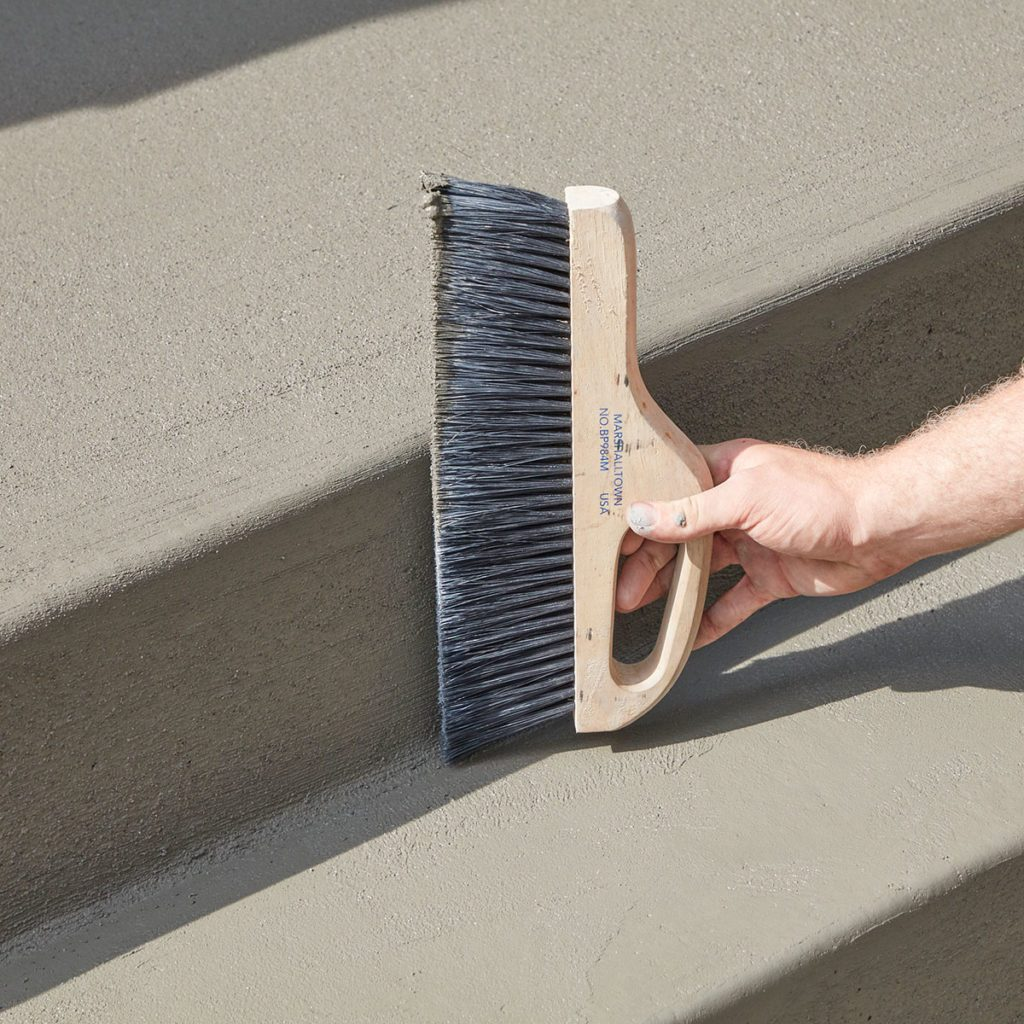 Brooming the edges of the step | Construction Pro Tips