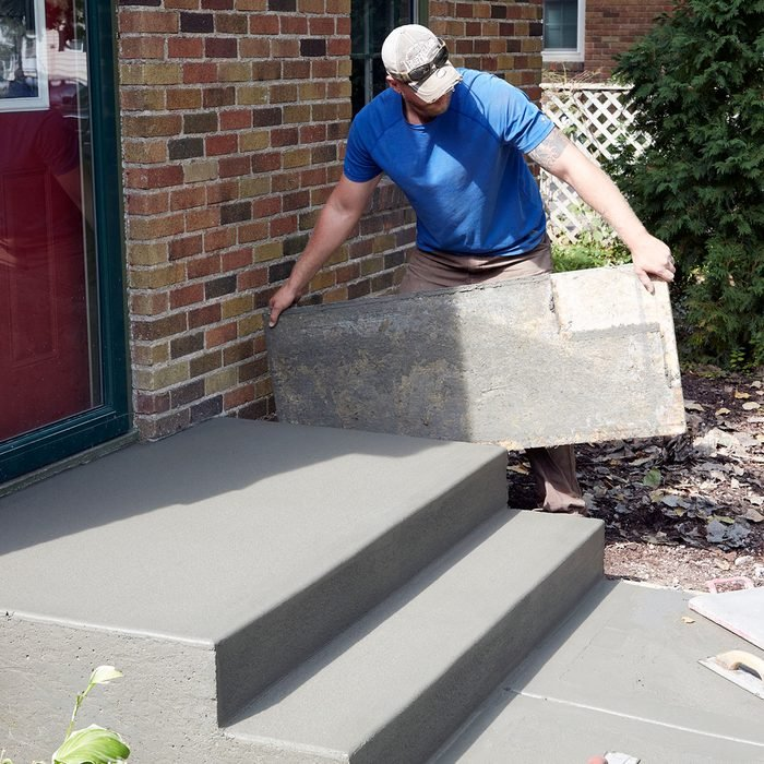 Pulling the side forms when the step is dry enough | Construction Pro Tips