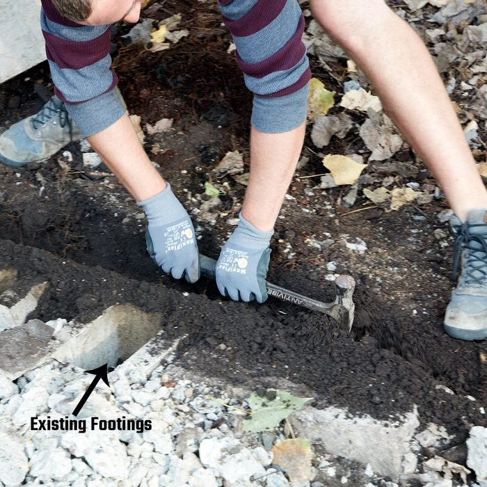 Digging a trench with a hammer for footings | Construction Pro Tips