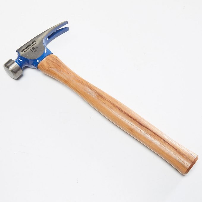 A hammer with a wooden handle | Construction Pro Tips