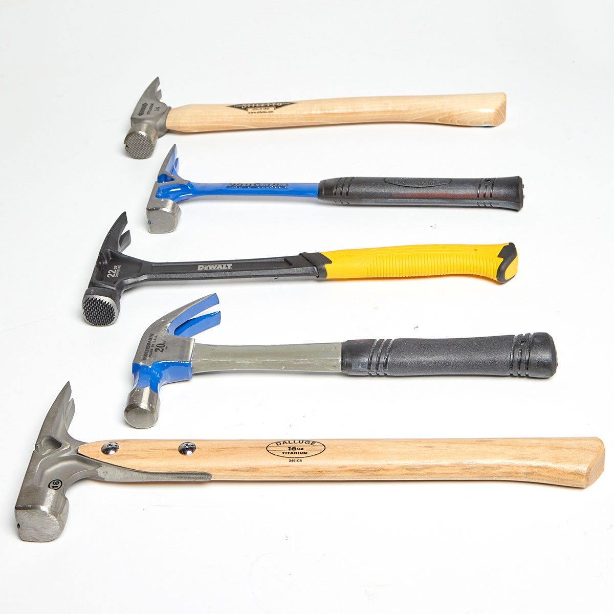 Five hammers laying on their sides   Construction Pro Tips