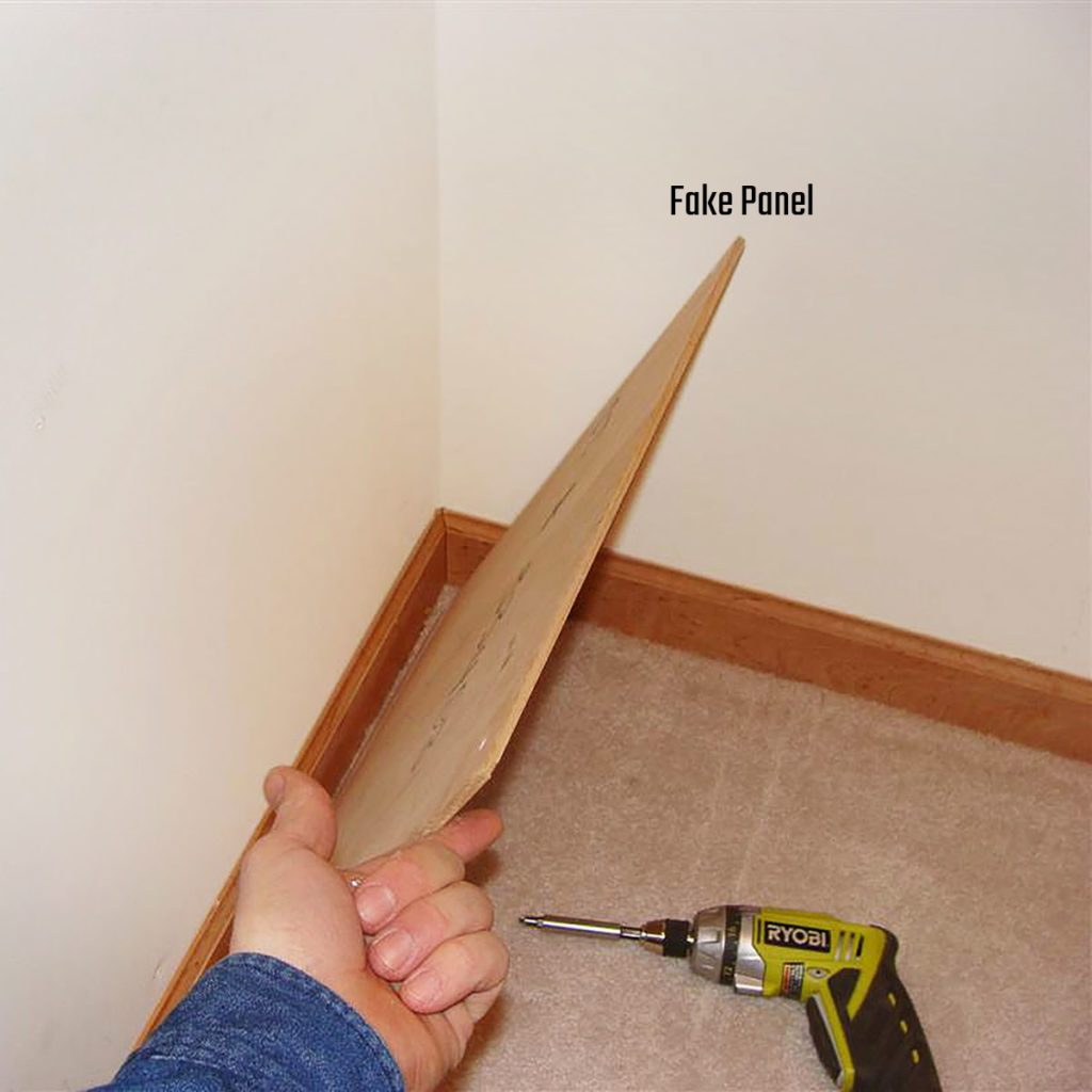 A board being propped up as a fake panel | Construction Pro Tips