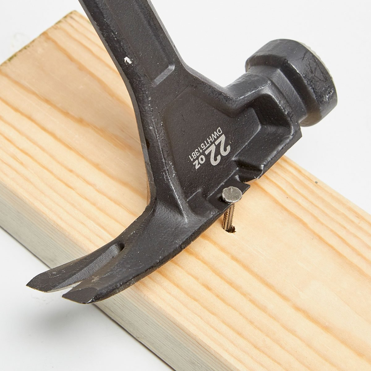 Nail being pulled by hammer with side-puller   Construction Pro Tips