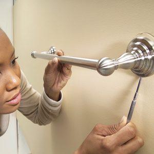 How to Permanently Anchor a Bathroom Towel Bar