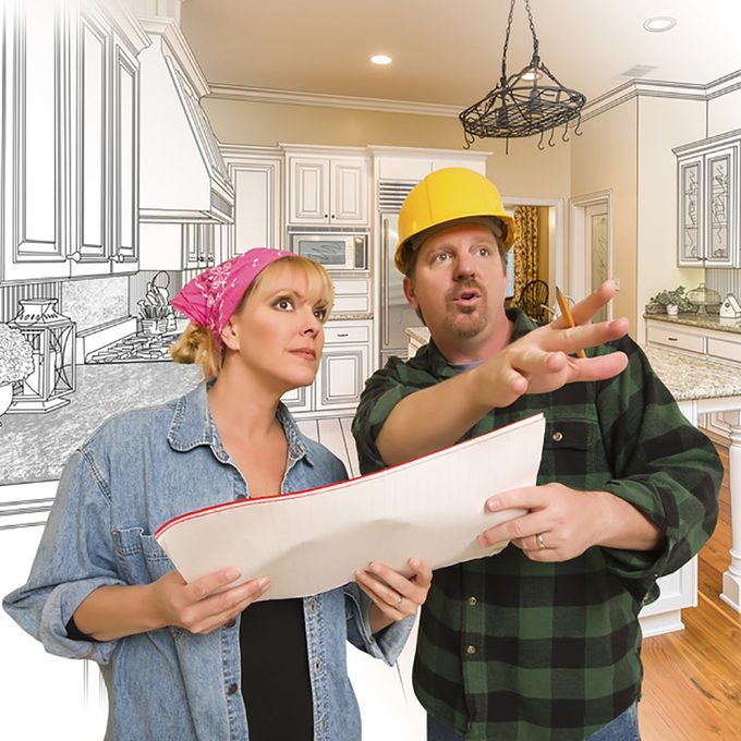 Contractor and homeowner looking over plans   Construction Pro Tips