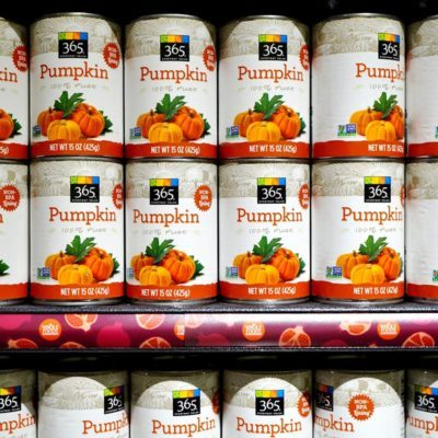 Cans of pumpkin puree lined up on the shelf from 365, the low cost brand of Whole Foods Market.