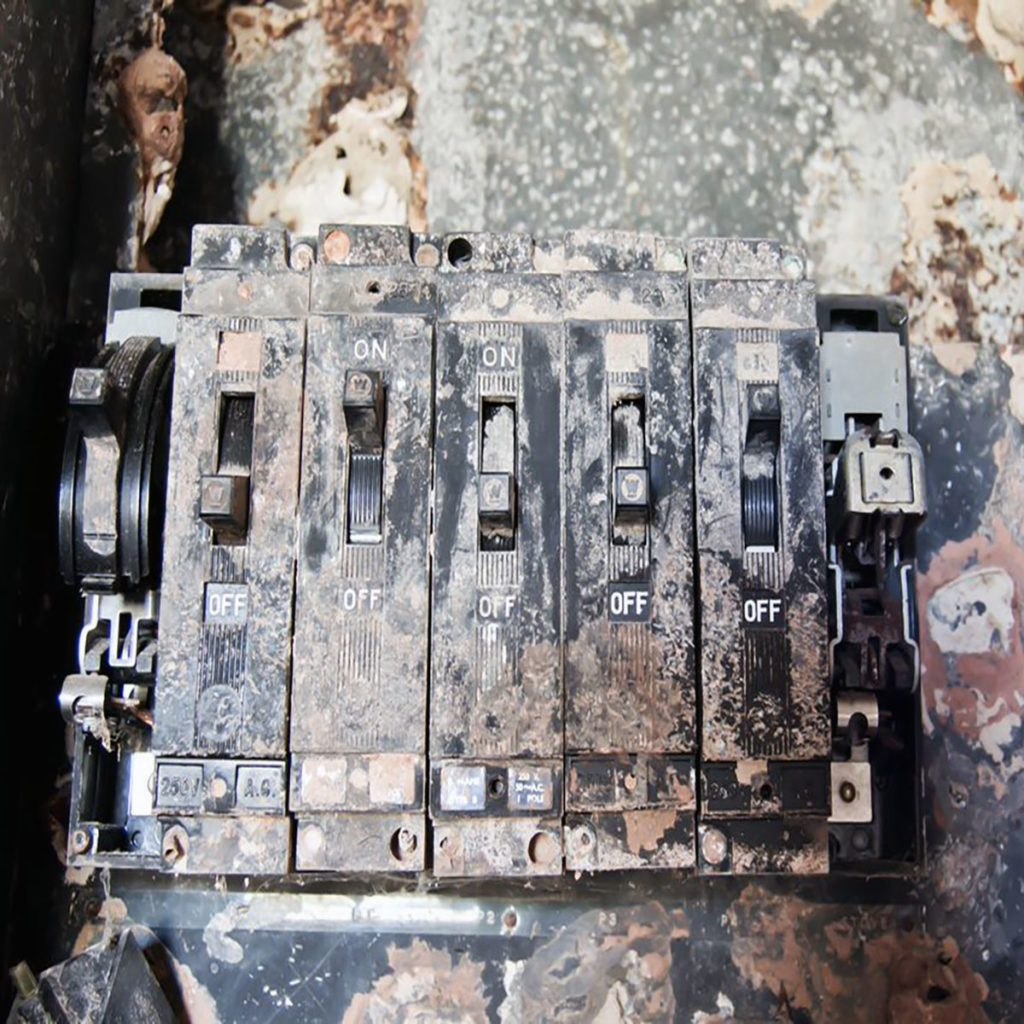 Corroded interior of an electrical panel | Construction Pro Tips