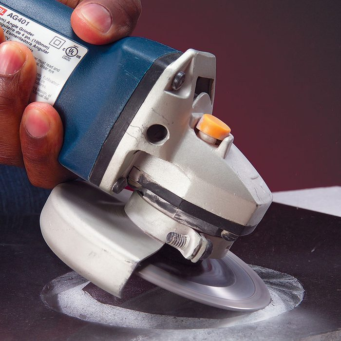 Cutting into tile with a grinder | Construction Pro Tips