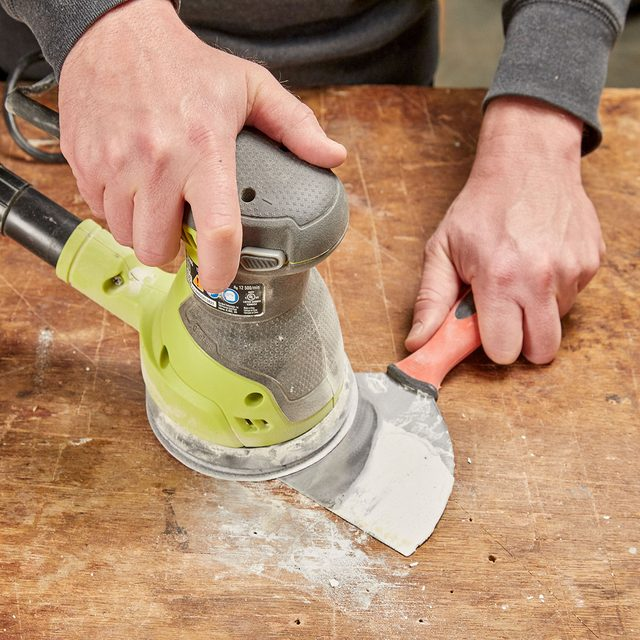 sanding drywall off of a drywall knife