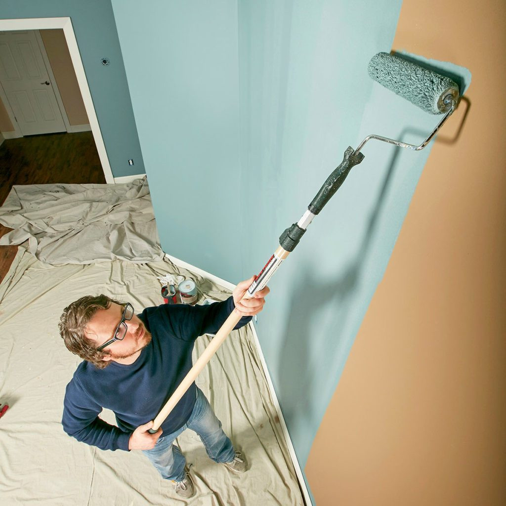 Painter rolling paint onto walls | Construction Pro Tips