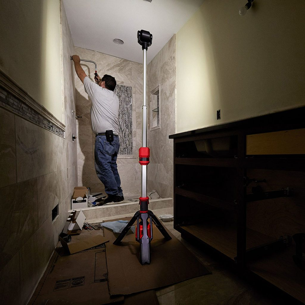 Worker using the M12 Rocket Tower Light to see | Construction Pro Tips