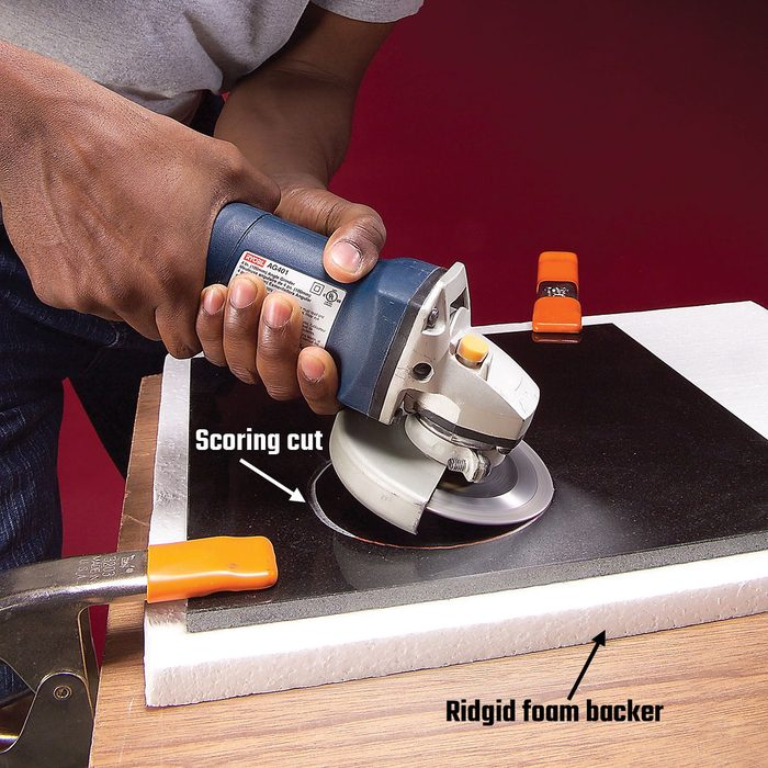 Starting circular cuts in tile by scoring the surface | Construction Pro Tips