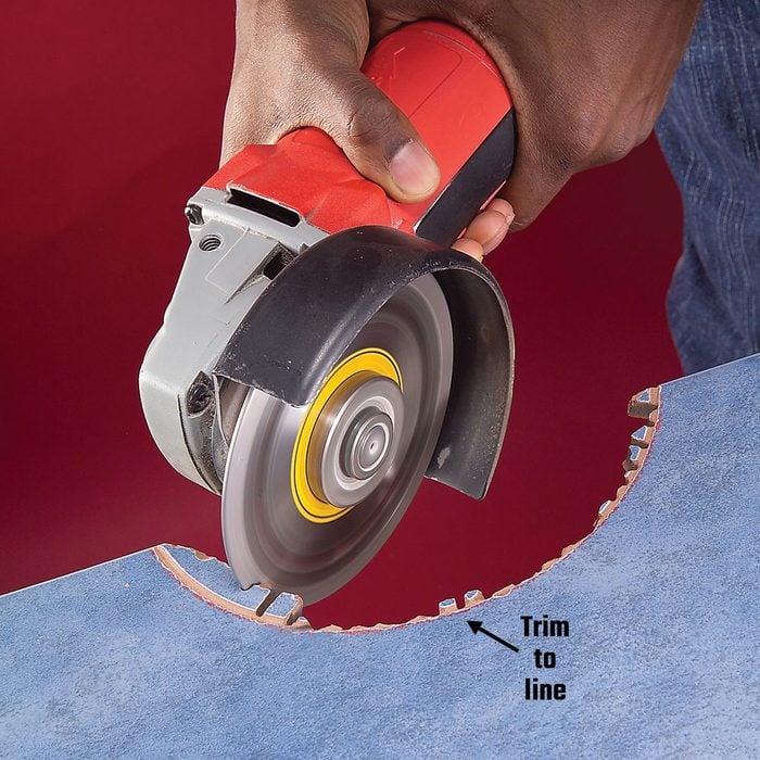 Making radial cuts into a semi-circular cut tile | Construction Pro Tips