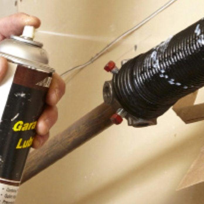 Lubricate the garage door spring