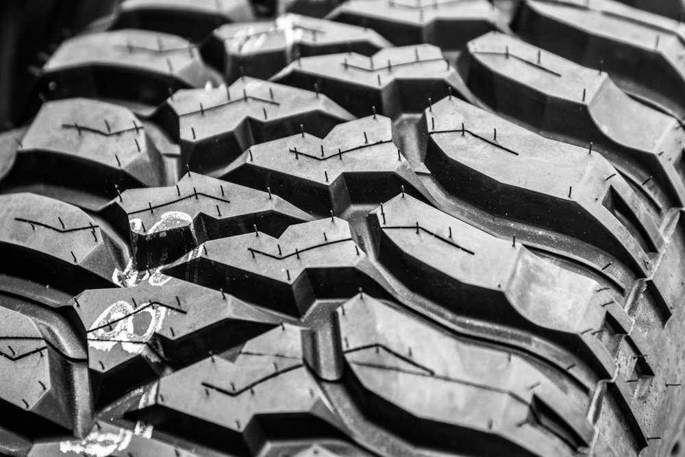 A macro shot of a performance tire, shallow depth of field.
